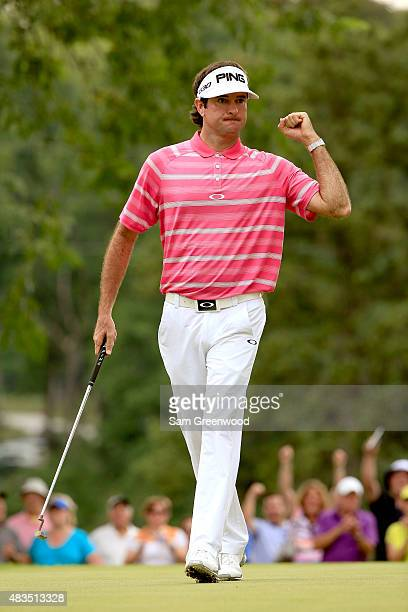 Bubba Watson reacts after a birdie putt on the 13th green during the final round of the World Golf Championships Bridgestone Invitational at...