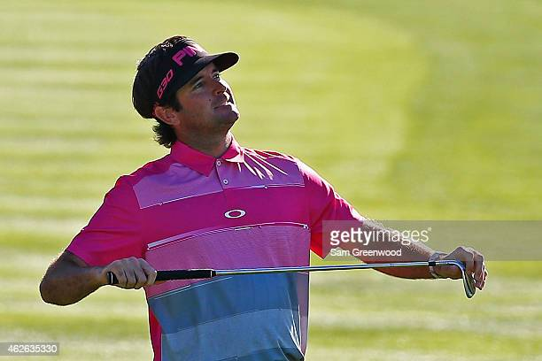 Bubba Watson reacts after hitting his second shot on the 18th hole during the fourth round of the Waste Management Phoenix Open at TPC Scottsdale on...