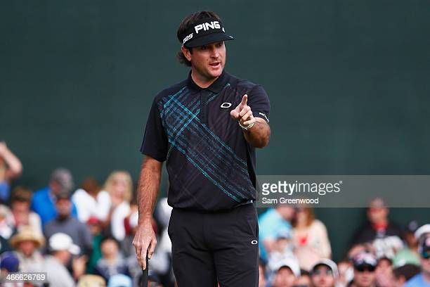 Bubba Watson reacts after missing a putt on the 18th hole during the final round of the Waste Management Phoenix Open at TPC Scottsdale on February 2...