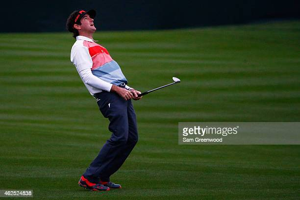 Bubba Watson reacts after playing a shot on the 10th fairway during the second round of the Waste Management Phoenix Open at TPC Scottsdale on...