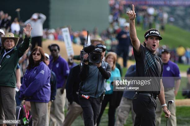 Bubba Watson reacts as he plays a shot on the 18th hole in the final round of the Waste Management Phoenix Open at TPC Scottsdale on February 2 2014...