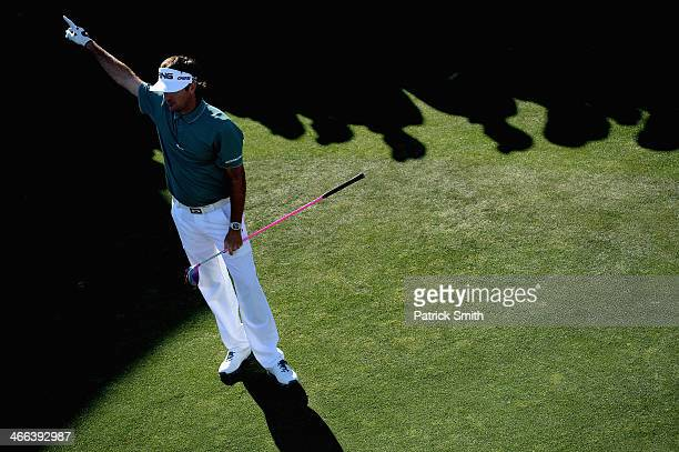 Bubba Watson reacts as he plays a tee shot on the 17th hole during the third round of the Waste Management Phoenix Open at TPC Scottsdale on February...