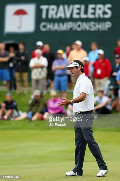 Bubba Watson reacts to a missed putt on the 17th green during the third round of the Travelers Championship at TPC River Highlands on June 27 2015 in...