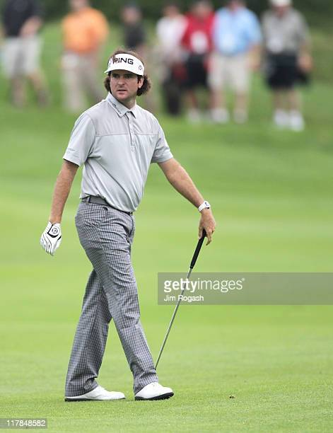 Bubba Watson reacts to his approach shot during the second round of the Travelers Championship at TPC River Highlands on June 24 2011 in Cromwell...