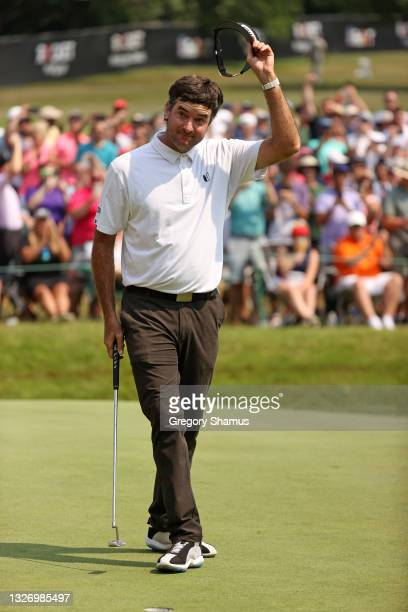 Bubba Watson reacts to his birdie putt on the 18th green during the final round of the Rocket Mortgage Classic on July 04, 2021 at the Detroit Golf...