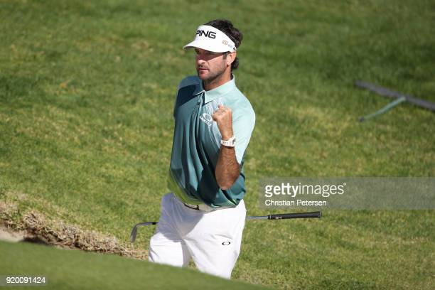Bubba Watson reacts to his shot from the bunker on the 14th hole during the final round of the Genesis Open at Riviera Country Club on February 18...