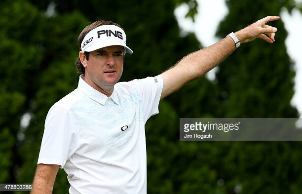 Bubba Watson reacts to his shot from the ninth tee during the third round of the Travelers Championship at TPC River Highlands on June 27 2015 in...