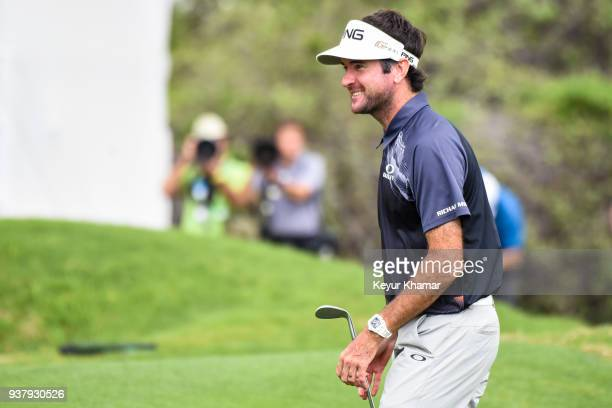 Bubba Watson smiles after his chip shot to the 12th hole green during the championship match at the World Golf ChampionshipsDell Technologies Match...