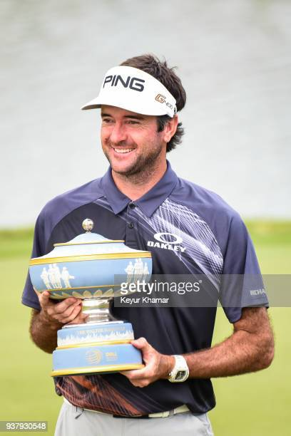 Bubba Watson smiles with the Walter Hagen Cup trophy on the 13th hole green following his 76 victory in the championship match at the World Golf...