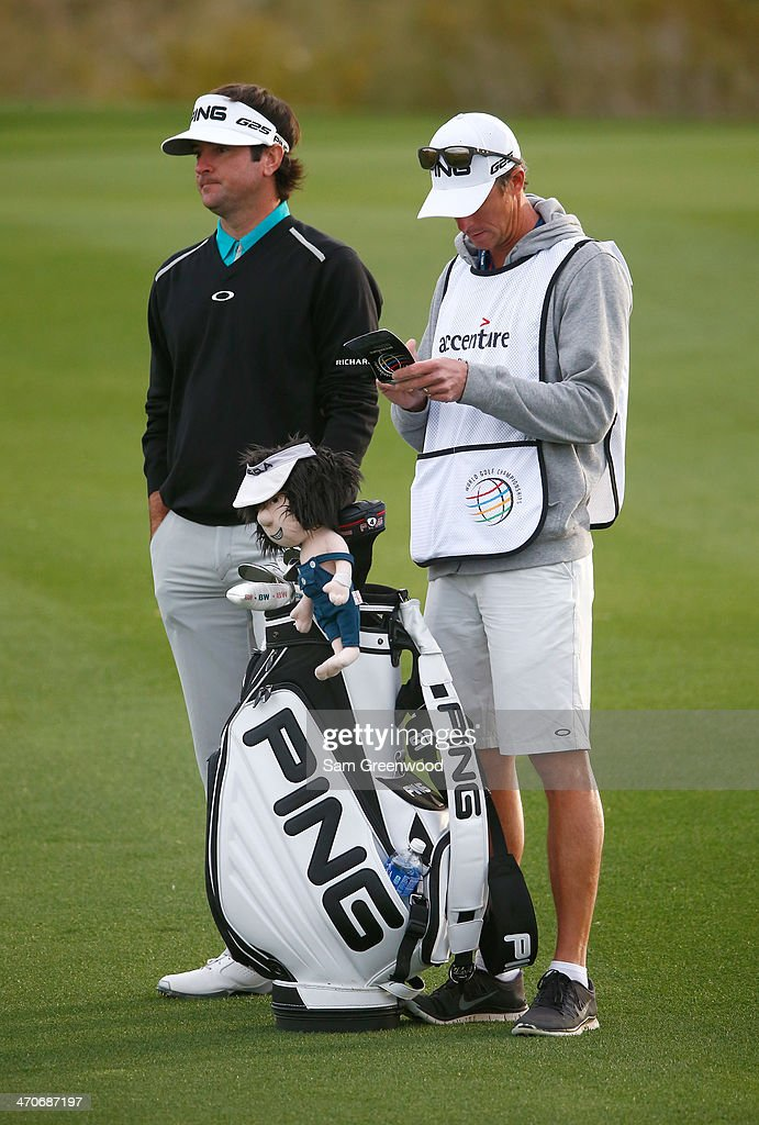 Bubba Watson stands with his caddie during the first round of the World Golf Championships - Accenture Match Play Championship at The Golf Club at Dove Mountain on February 19, 2014 in Marana, Arizona.