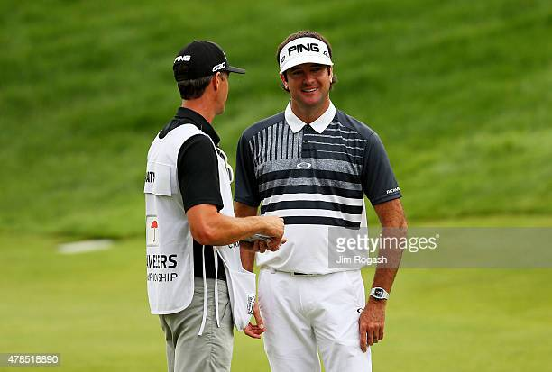 Bubba Watson talks to his caddie Ted Scott during the first round of the Travelers Championship at TPC River Highlands on June 25 2015 in Cromwell...