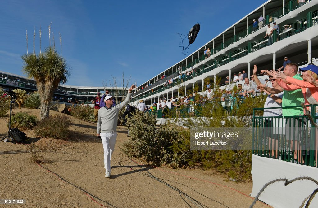 Bubba Watson throws bags to fans on the 16th hole during the second round of the Waste Management Phoenix Open at TPC Scottsdale on February 2, 2018 in Scottsdale, Arizona.