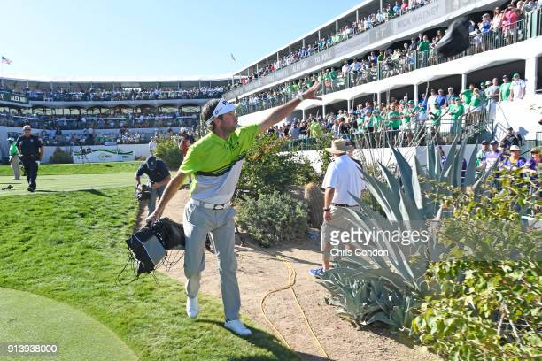 Bubba Watson tosses gifts into the crowd on the 16th hole during the third round of the Waste Management Phoenix Open at TPC Scottsdale on February 3...