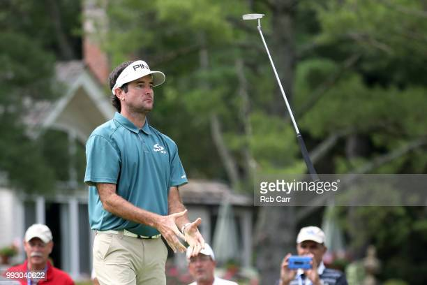 Bubba Watson tosses his putter in the air after missing a birdie putt on the 10th hole during round two of A Military Tribute At The Greenbrier held...
