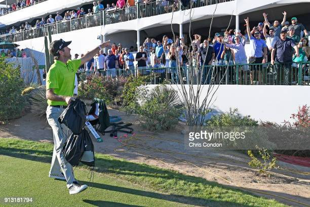 Bubba Watson tosses Oakley gifts to the gallery on the 16th hole during the first round of the Waste Management Phoenix Open at TPC Scottsdale on...