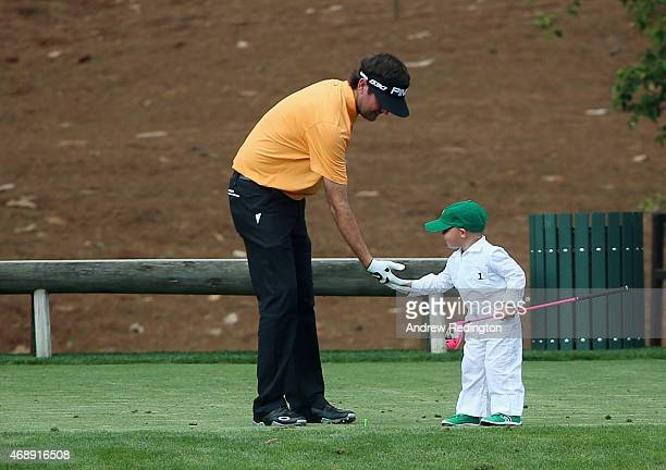 Bubba Watson waits with his son Caleb during the Par 3 Contest prior to the start of the 2015 Masters Tournament at Augusta National Golf Club on...