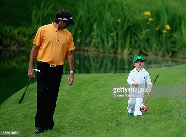 Bubba Watson walks with his son Caleb during the Par 3 Contest prior to the start of the 2015 Masters Tournament at Augusta National Golf Club on...