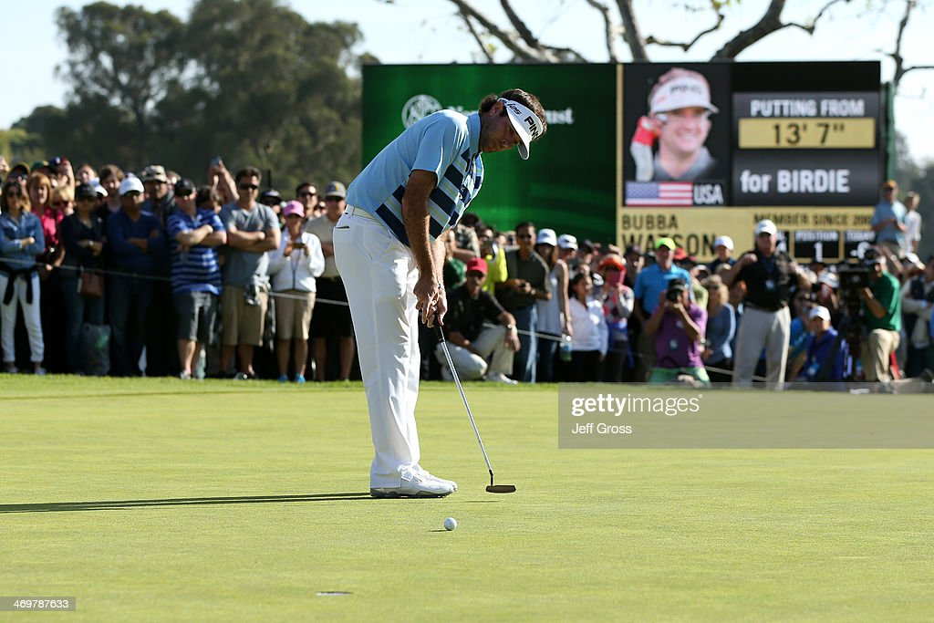 Bubba Watson watches his birdie putt on the 18th green to win the Northern Trust Open at the Riviera Country Club on February 16, 2014 in Pacific Palisades, California.