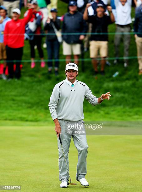 Bubba Watson waves to the gallery after winning the final round of the Travelers Championship in a playoff against Paul Casey of England at TPC River...