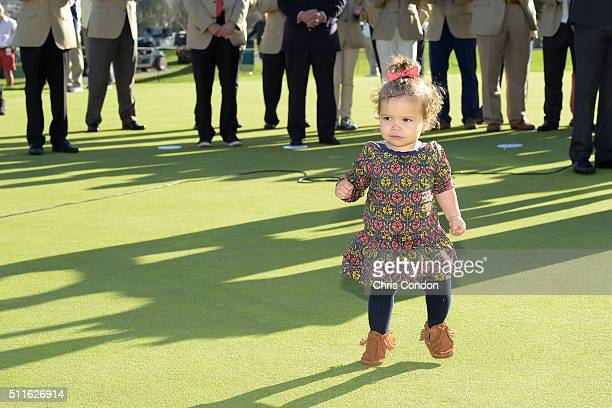 Bubba Watson's daughter Dakota runs on to the 18th green during the trophy ceremony after Watson wins the Northern Trust Open at Riviera Country Club...