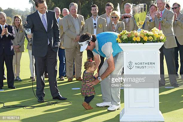 Bubba Watson's daughter Dakota runs to her dad during the trophy ceremony after Watson wins the Northern Trust Open at Riviera Country Club on...