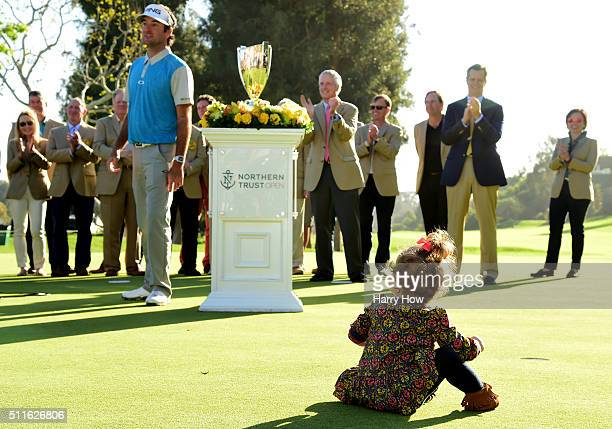 Bubba Watson's daughter Dakota watches during the trophy presentation on the 18th hole during the final round of the Northern Trust Open at Riviera...