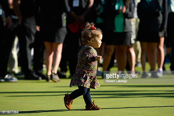 Bubba Watson's daugter Dakota Watson looks on during the trophy ceremony after the final round of the Northern Trust Open at Riviera Country Club on...