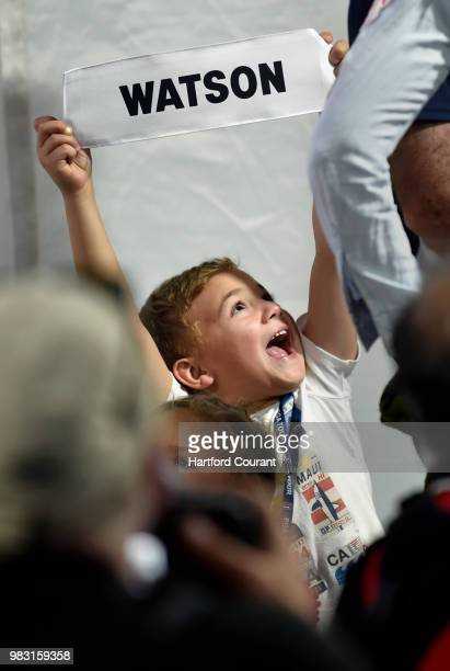 Bubba Watson's son Caleb Watson holds up his father's caddie bib name tag at the victory ceremony after the final round of the Travelers Championship...