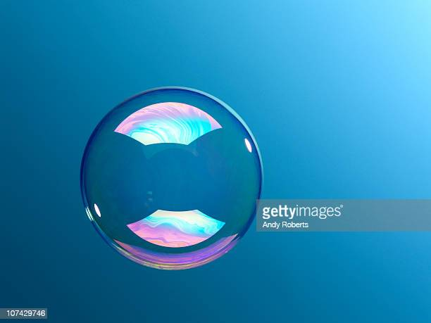 Bubble floating against blue background