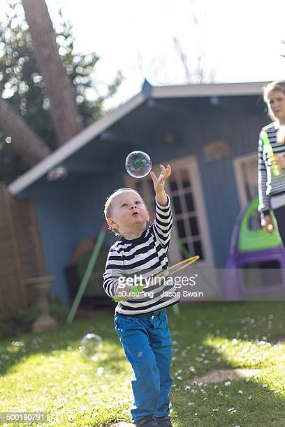 bubble fun in the garden - s0ulsurfing stock pictures, royalty-free photos & images