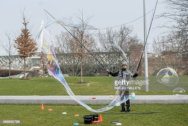 Bubbleologist Sam Heath otherwise know as Samsam Bubbleman attempts to break his tenth Guinness World Record by creating a 23 cubic metres bubble in...