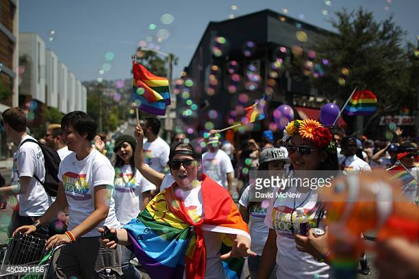 Bubbles float around people marching in the LA Pride Parade on June 8 2014 in West Hollywood California The LA Pride Parade and weekend events this...