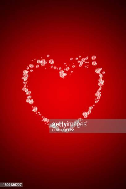 bubbles forming a heart shape - atomic imagery stock pictures, royalty-free photos & images