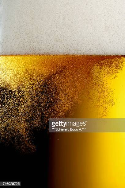 bubbles in a beer glass (close-up) - carbon dioxide stock photos and pictures