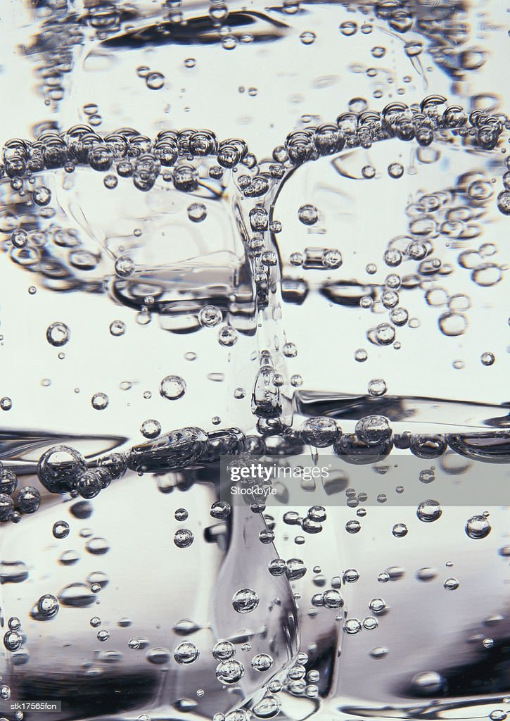 bubbles in a glass of  liquid : Stock Photo