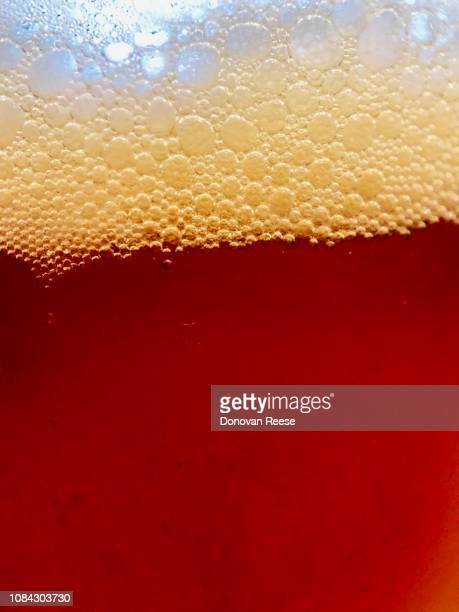 bubbles in the head of ipa beer - help:ipa stock pictures, royalty-free photos & images