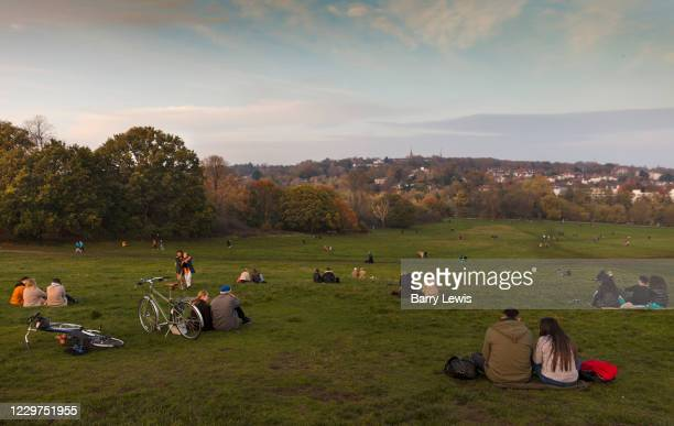 Bubbles of people observing social distancing on Parliament Hill, Hampstead Heath during the second national coronavirus lockdown on 7th November...