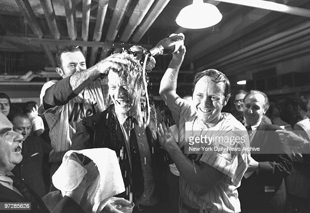 Bubbling over with excitement Jerry Grote [left] and Rod Gaspar give Mayor John Lindsay a bath in champagne in wild clubhouse celebration at Shea...