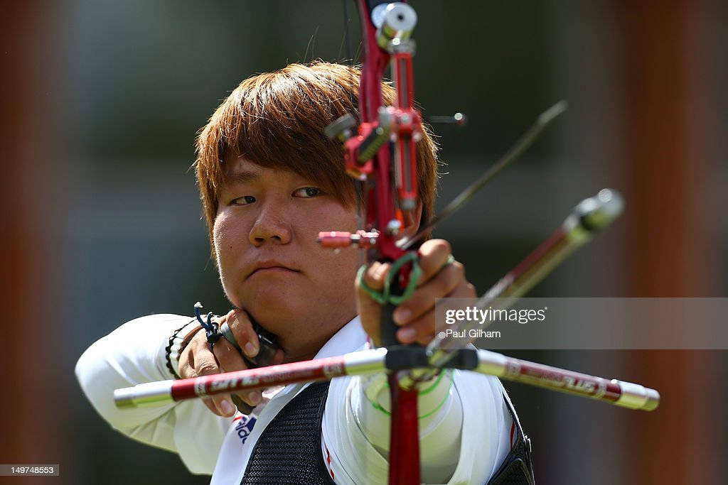 Bubmin Kim of Korea competes against Xiaoxiang Dai of China during the Men's Individual Archery Quarterfinal match on Day 7 of the London 2012 Olympic Games at Lord's Cricket Ground on August 3, 2012 in London, England.