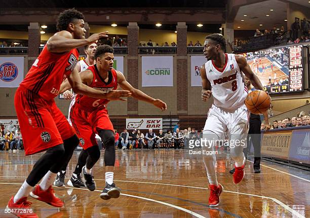 Bubu Palo of the Sioux Falls Skyforce dribbles the ball while guarded by Axel Toupane and Ronald Roberts Jr #13 of the Toronto Raptors 905 at the...
