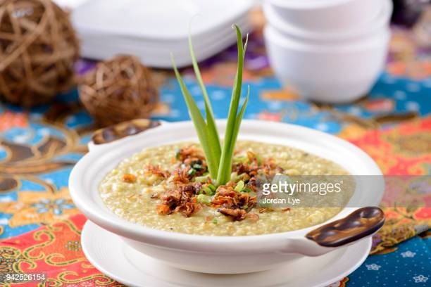 bubur lambuk - congee stock photos and pictures