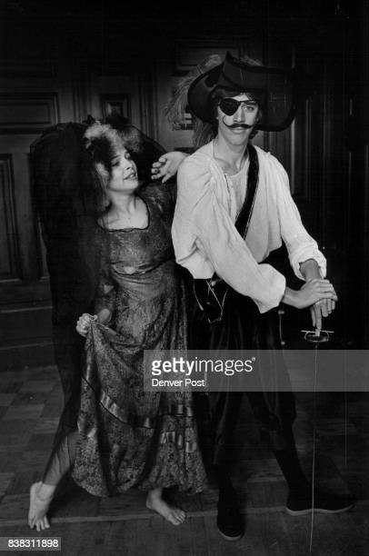 Buccaneer Todd L Collard with bride of Frankenstein who wears antique wedding gown dyed black frizzy wig black tulle veil Collard's plumed hat is $60...