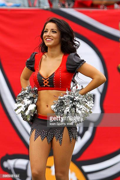 Buccaneers cheerleader entertains the fans during the NFL game between the Dallas Cowboys and Tampa Bay Buccaneers at Raymond James Stadium in Tampa...