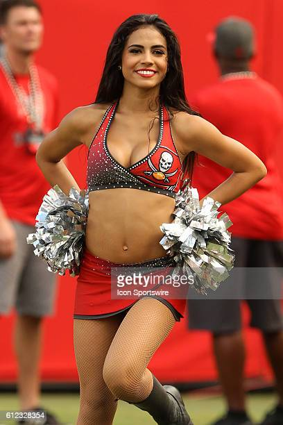 Buccaneers cheerleader entertains the fans during the regular season game between the Denver Broncos and the Tampa Bay Buccaneers at Raymond James...