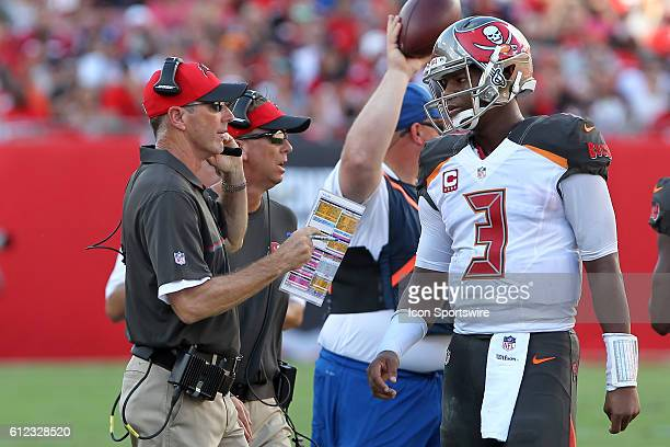 Buccaneers Head Coach Dirk Koetter has a word with quarterback Jameis Winston during the regular season game between the Denver Broncos and the Tampa...