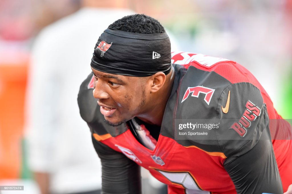 Buccaneers quarterback Jameis Winston (3) discuss the previous interception on bench during the first half of an NFL game between the New Orleans Saints and the Tampa Bay Buccaneers on December 31, 2017, at Raymond James Stadium in Tampa, FL.