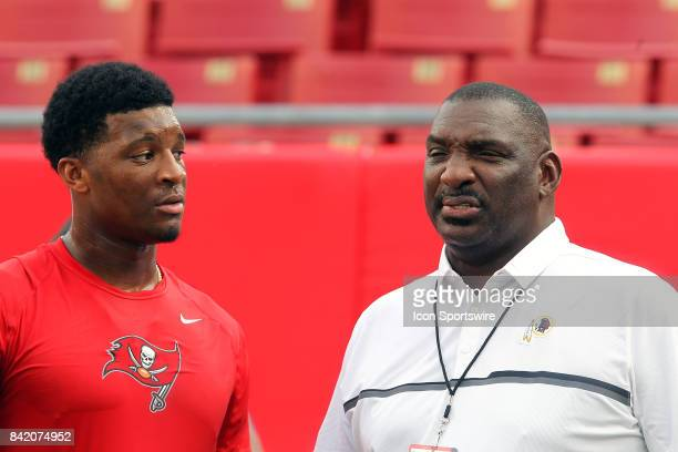 Buccaneers quarterback Jameis Winston has a word with former Tampa Bay Buccaneers quarterback and Redskins executive Doug Williams before the NFL...