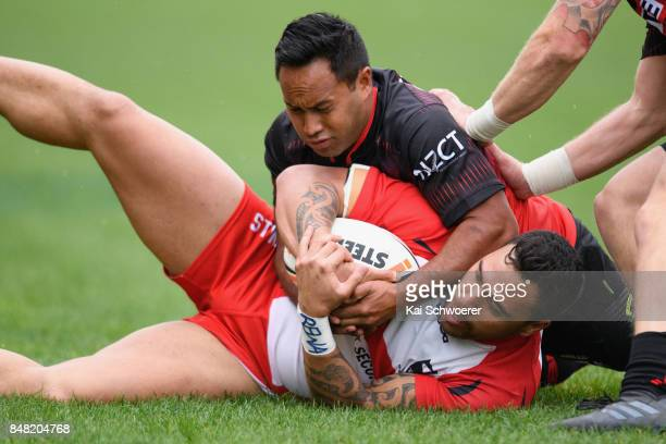 Buchanan Rawhiti of Counties Manukau is tackled by Tama Walker of Canterbury during the NZ Rugby League Premiership round one match between the...