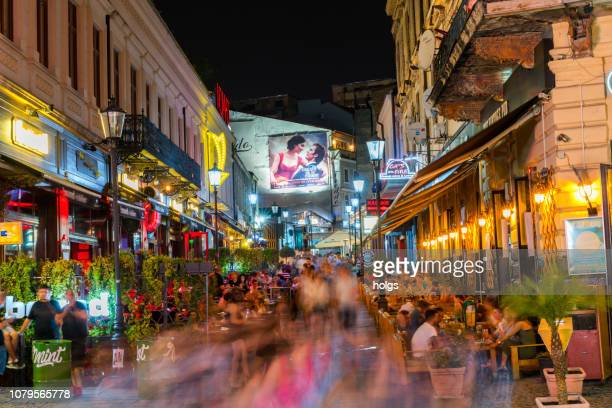 bucharest old town square and outdoor cafes at night in bucharest, romania, europe - bucharest stock pictures, royalty-free photos & images