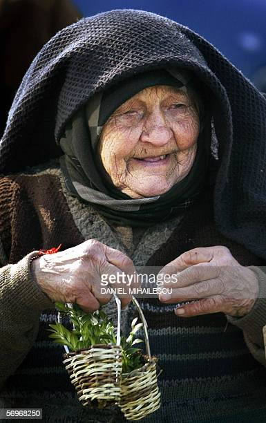 An old Romanian woman sell snowdrops in Bucharest 01 March 2006 According to Romanian tradition men offer women snowdrops or little pieces of...